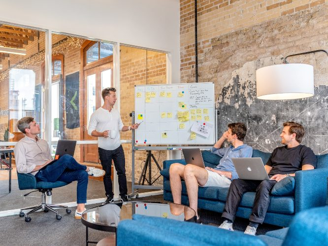 a team in a meeting discuss user experience