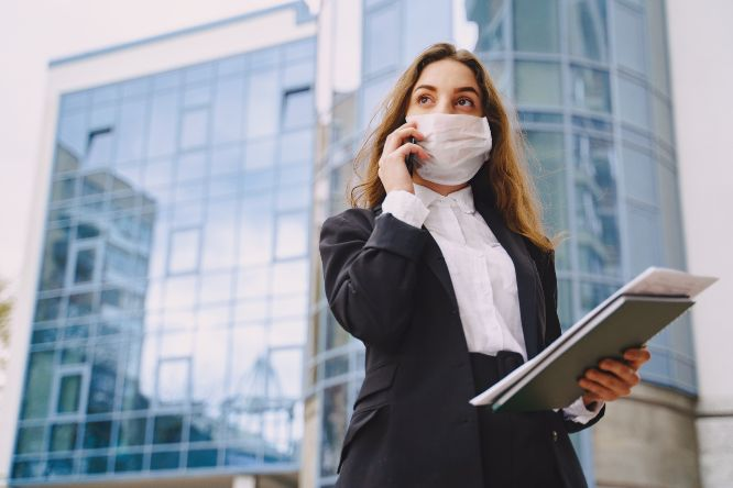 businesswoman-standing-outdoors-city-office-building-36102