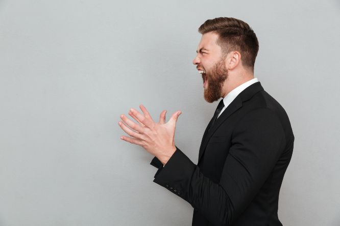 man-suit-shouting-gesturing-with-hands_8080776