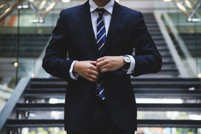 businessman suit stairs watch tie