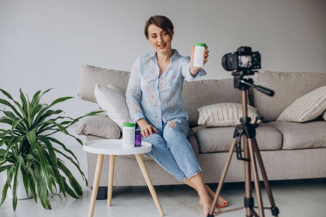 young-woman-blogger-recording-video-camera